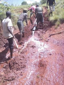The water pipeline in Gitega, Burundi is layed by hand.